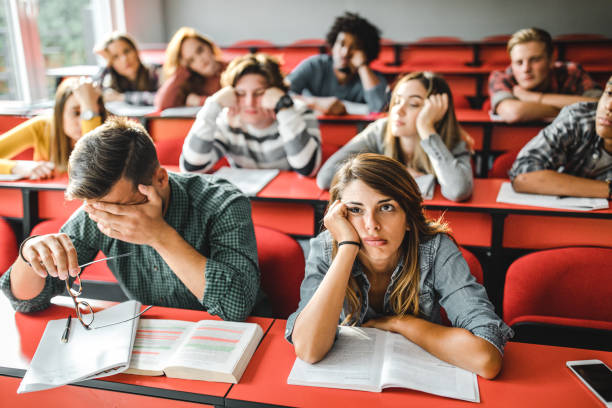 large group of bored students at lecture hall. - noia foto e immagini stock