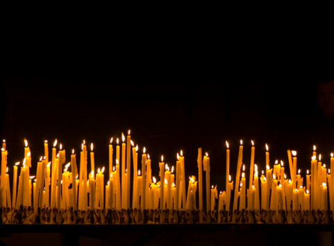 Large group of burning candles