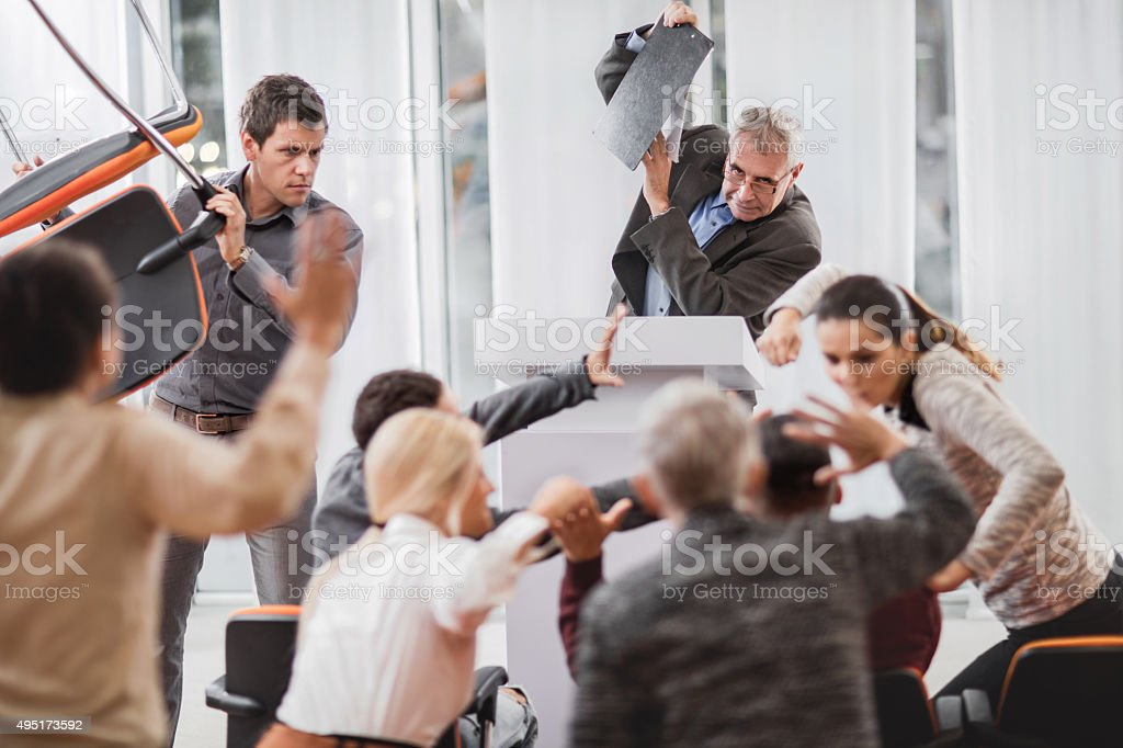 Large group of business people having a fight on seminar. stock photo