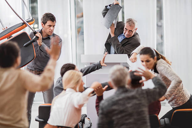 large group of business people having a fight on seminar. - chaos stockfoto's en -beelden