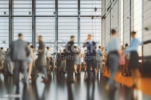 istock Large group of business people in convention centre 1281724535