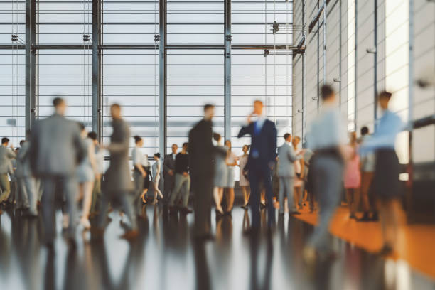 Large group of business people in convention centre stock photo