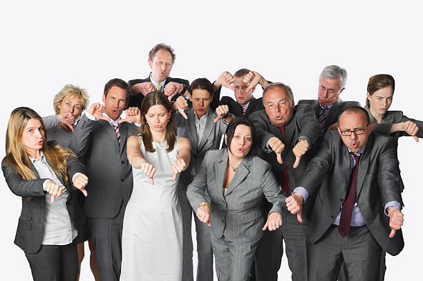large group of business people showing thumbs down, cut-out - thumbs down stock photos and pictures