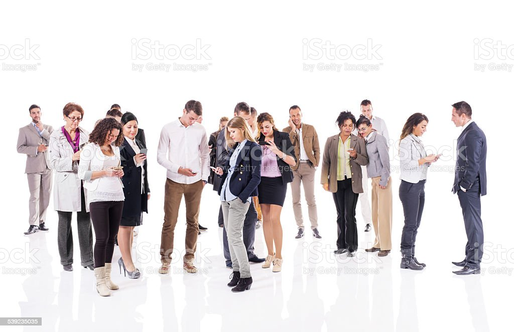 Large group of business people text messaging on smart phones. stock photo