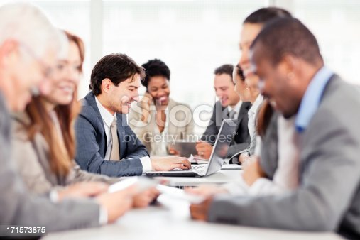 istock large Group of  businesspeople having a meeting. 171573875