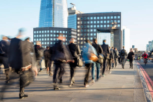 large group of businesspeople walking in london financial district, blurred motion - people uk stock photos and pictures