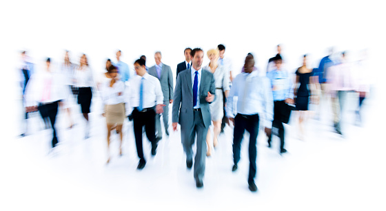 istock Large group of businesspeople walking on white background 165621839