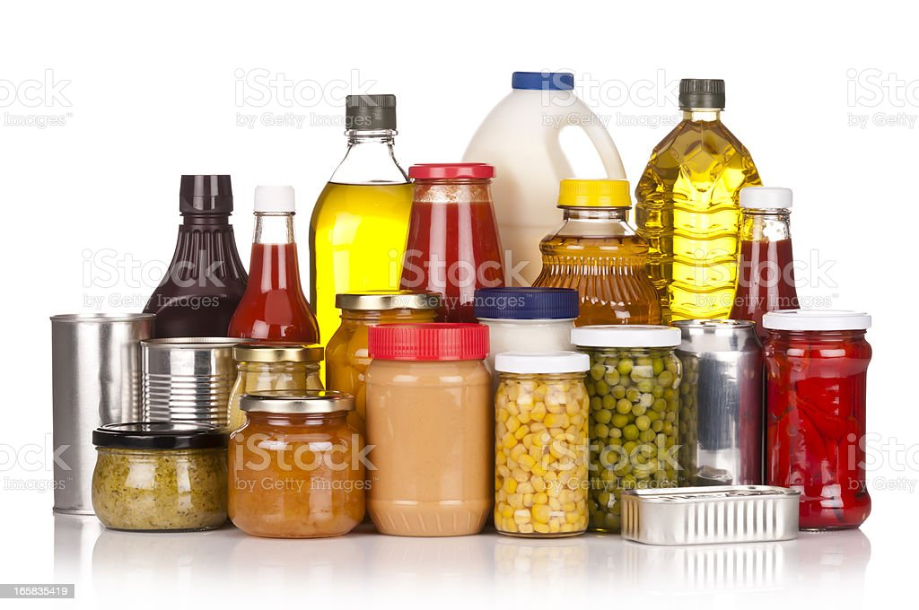 Large group of canned food sitting on white backdrop stock photo