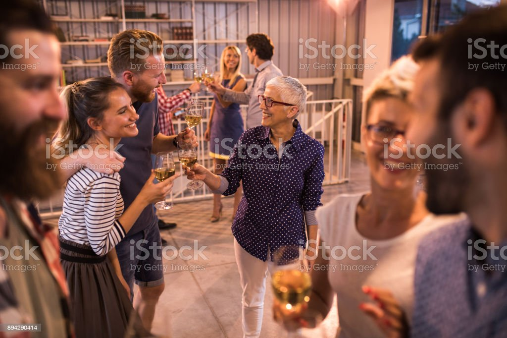 Large group of casual business people having fun at office party. stock photo