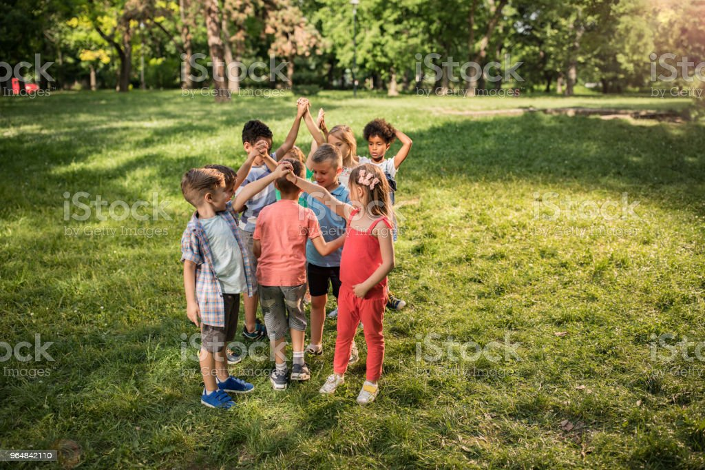 Large group of children playing leisure games in the park. royalty-free stock photo