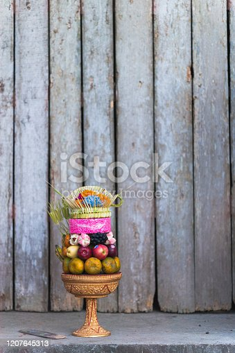 large group of colourful offerings on the ground outside a temple in Ubud Bali