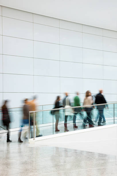 Large Group of Commuters Walking in Corridor, Blurred Motion stock photo