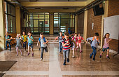 istock Large group of elementary students running in the school hallway. 1061231950