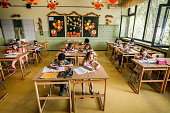 istock Large group of elementary students writing a dictation in the classroom. 1038328354