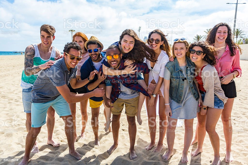 Large Group of Friends Having Fun on A Beach royalty-free stock photo