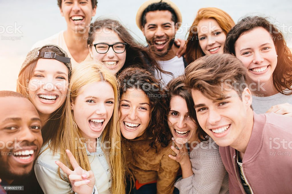 Large group of friends portrait at the beach stock photo