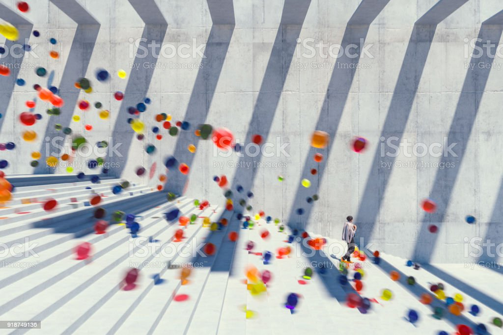 Large group of glowing spheres falling down the urban concrete stairs stock photo