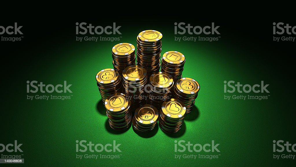 Large group of gold poker chips on green royalty-free stock photo