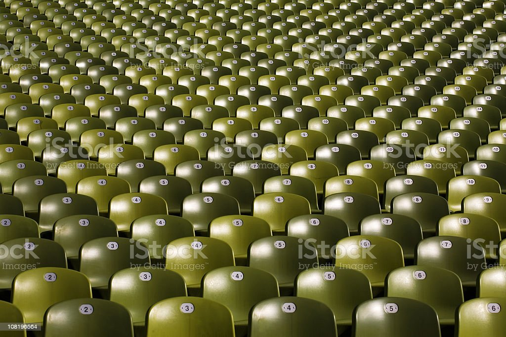 large group of green plastic seats in symetric rows royalty-free stock photo