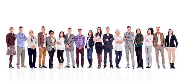 Large group of happy business people in a line. Large group of smiling business people standing in a line and looking at the camera. Isolated on white. people in a row stock pictures, royalty-free photos & images
