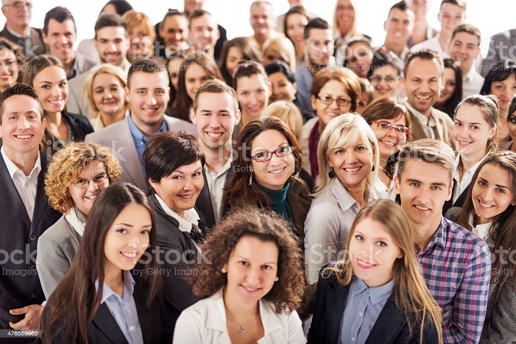 Large group of happy business people looking at the camera. stock photo