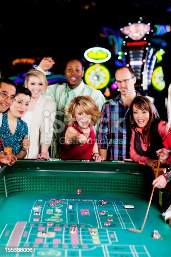 Large group of happy diverse people gambling at the craps table. You might also be interested in these: