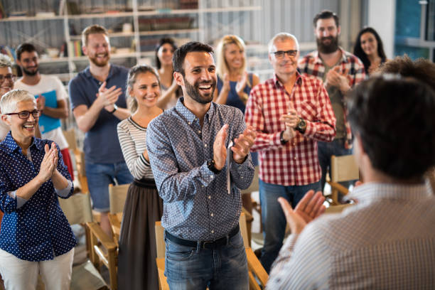large group of happy entrepreneurs applauding their colleague on a seminar. - audience clapping stock photos and pictures