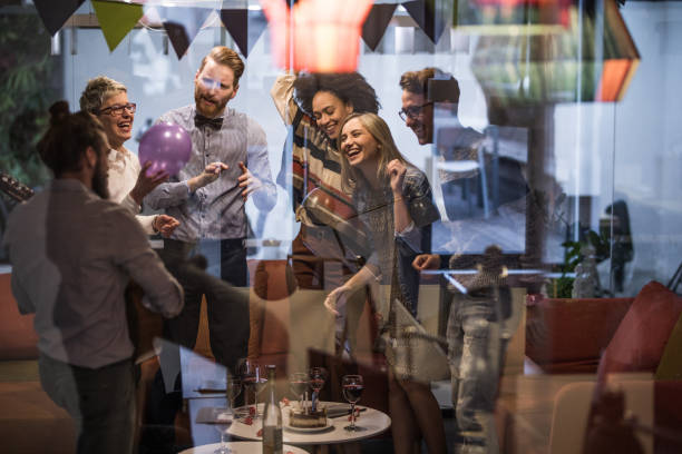 Large group of happy entrepreneurs dancing during office party. stock photo