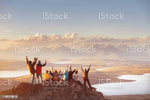 Photo of Large group of happy friends in mountains area