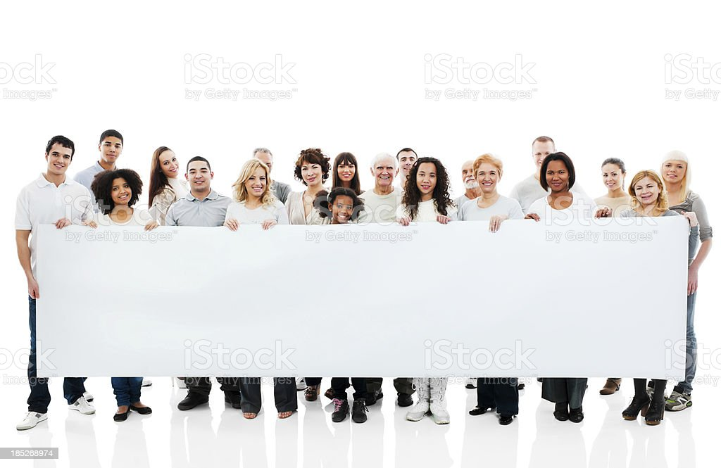 Large group of happy people holding a big white board. stock photo
