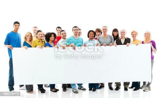istock Large group of happy people holding a big white board. 185278501