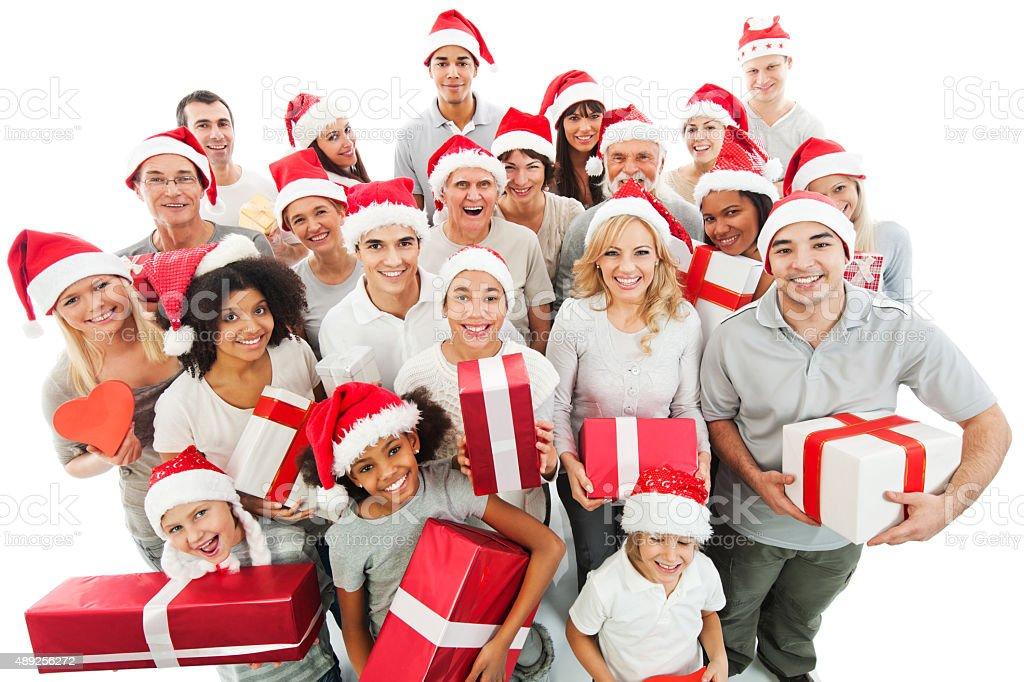 Gente Feliz En Navidad.Gran Grupo De Gente Que Sujeta Feliz Navidad Presenta Foto