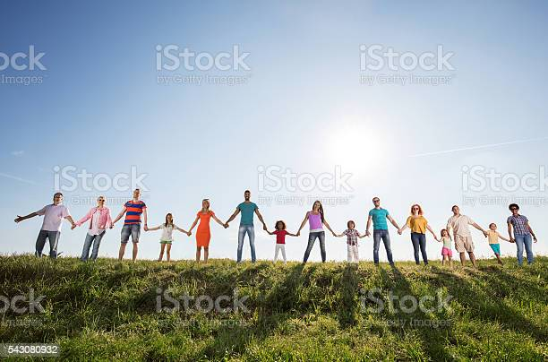 Large group of happy people holding hands against the sky picture id543080932?b=1&k=6&m=543080932&s=612x612&h=7vsvyis dqyxfycqvw 8kptmaj7ac7kbig85cqfd ye=