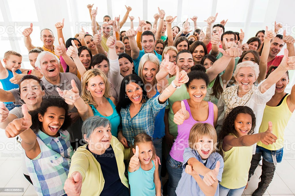 Large group of happy people showing thumbs up. stock photo