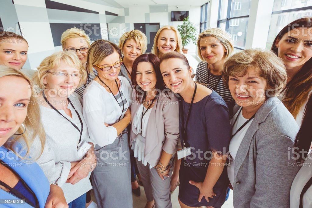 Large group of happy women on seminar Portrait of large group of happy woman during conference, smiling at the camera. Active Seniors Stock Photo