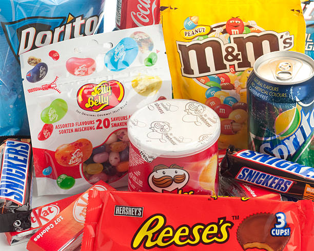 large group of junk food close up. - kit kat stock photos and pictures