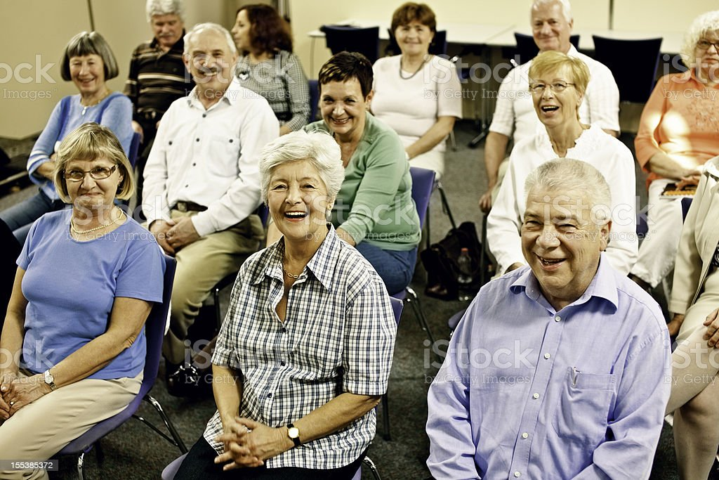 Large group of laughing seniors royalty-free stock photo