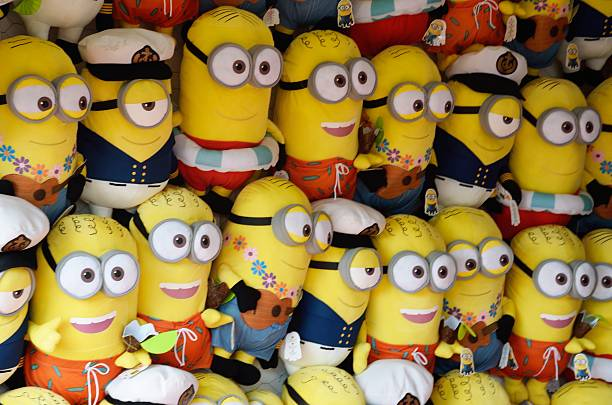 large group of minions  soft toys - minion thema stock-fotos und bilder