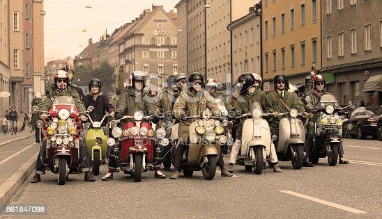 STOCKHOLM, SWEDEN - SEPT 02, 2017: Large group of mods on old fashioned vespas at the Mods vs Rockers event at the Saint Eriks bridge, Stockholm, Sweden, September 02, 2017