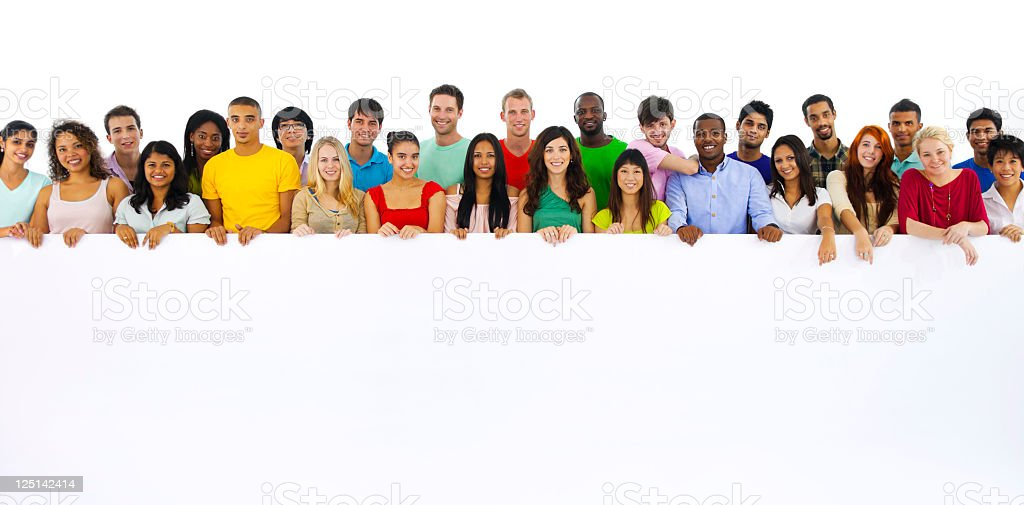 Large group of multi ethnic youths holding a placard royalty-free stock photo