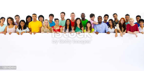 istock Large group of multi ethnic youths holding a placard 125142414