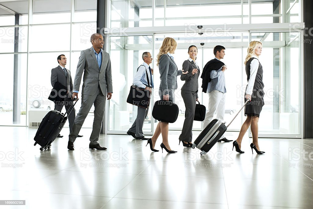 Large group of multiethnic business people walking at corridor royalty-free stock photo