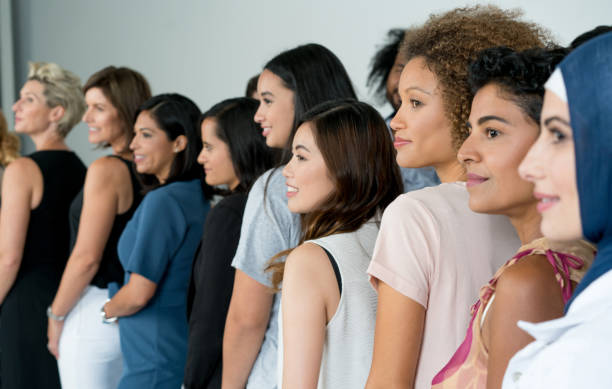 Large group of multi-ethnic women smiling stock photo