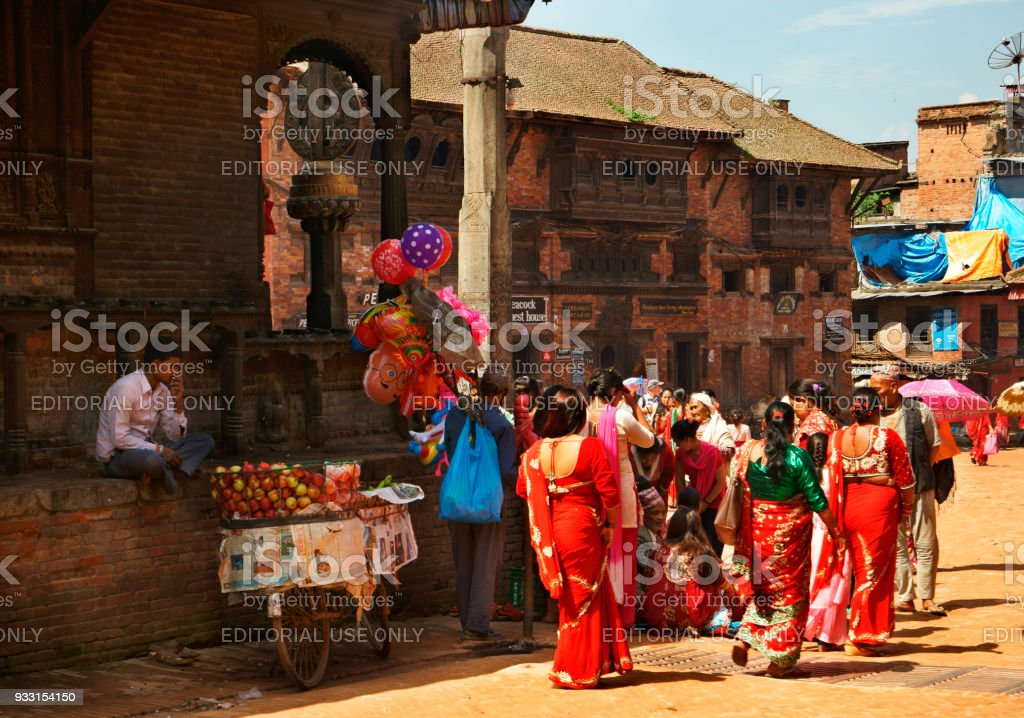 large group of nepalese women in traditional clothing at temple stock photo