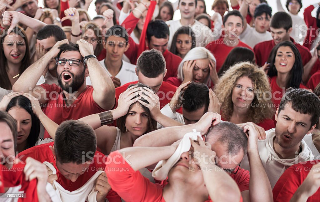 Large group of of disappointed fans. stock photo