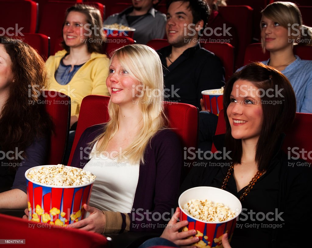 large group of people are watching  a movie royalty-free stock photo