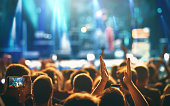 istock Large group of people at a concert party. 1311329449