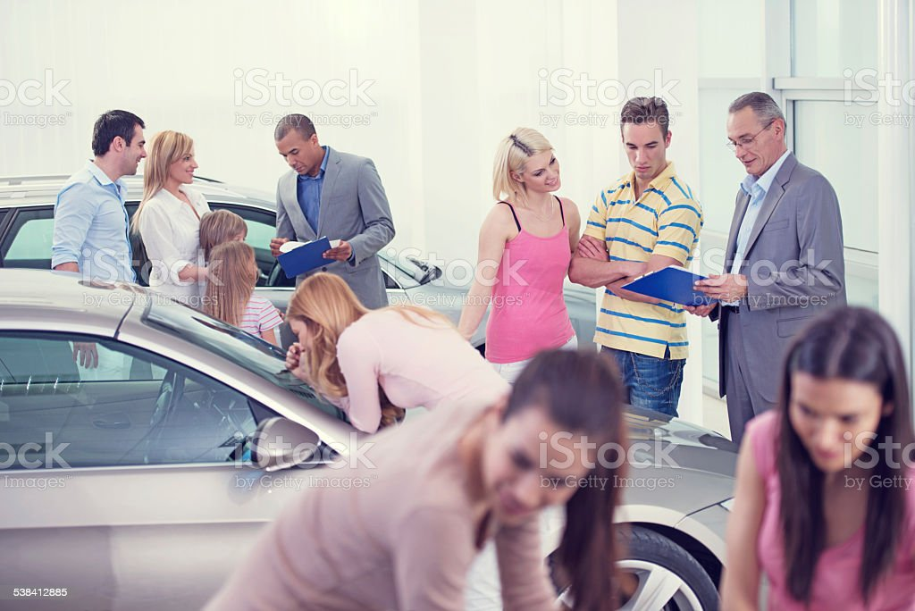 Large group of people at the car exhibition. stock photo