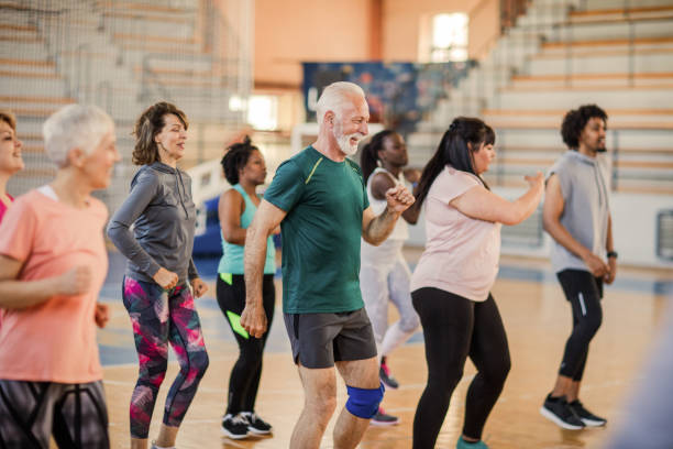 Large group of people dancing at Zumba class stock photo