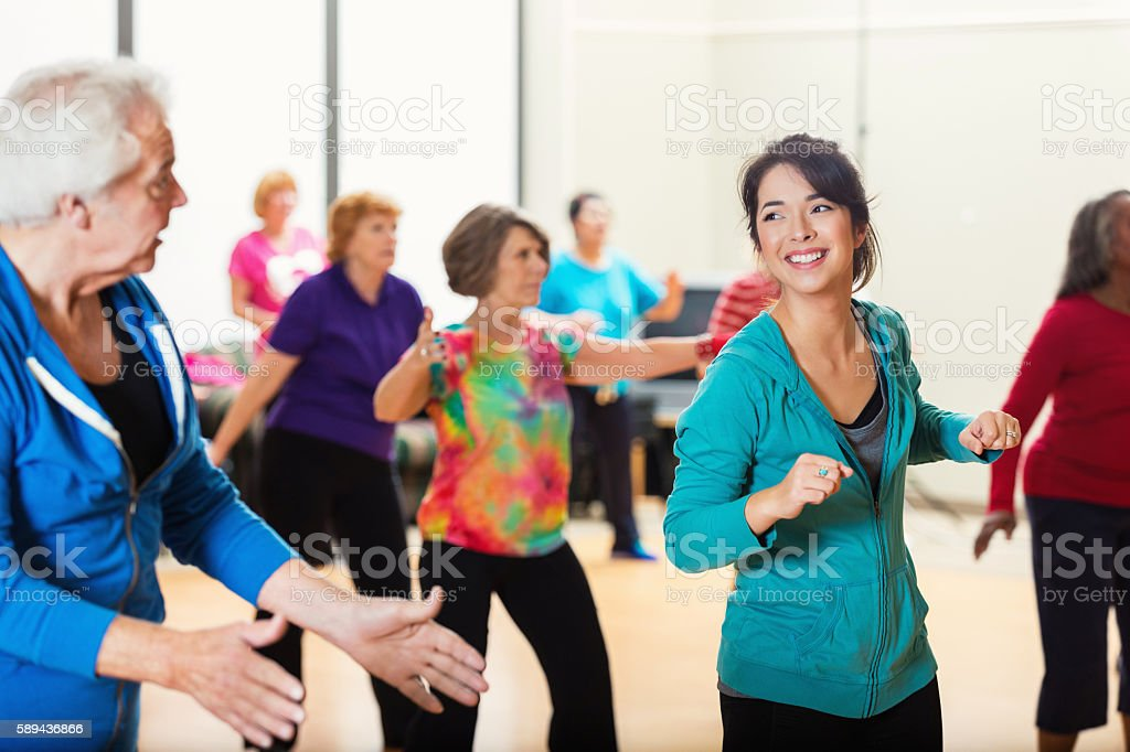 Large group of people enjoying dance lessons stock photo